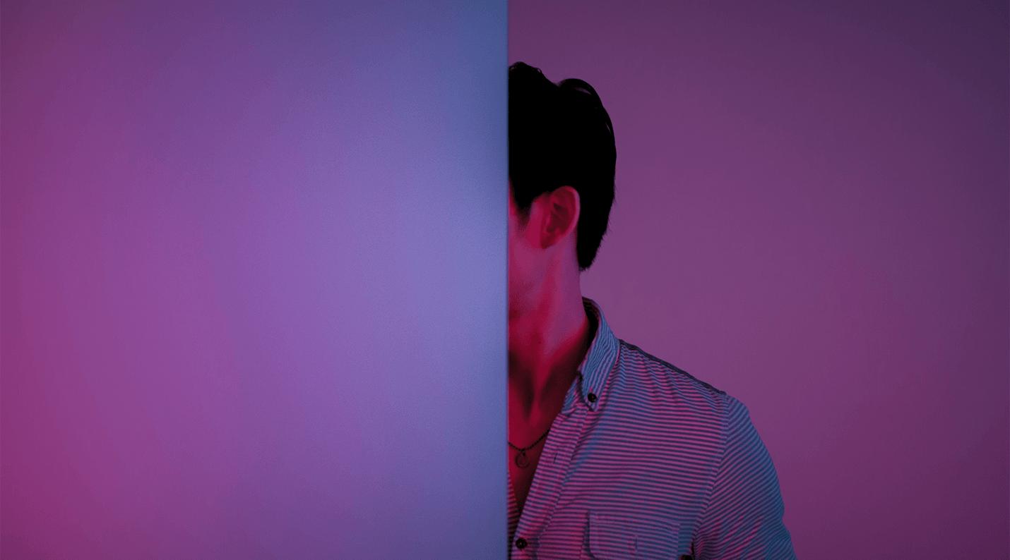 image of man half behind door to represent hidden cost of reminders