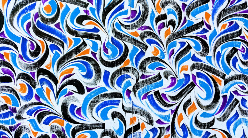 abstract wall art in orange, purple, and blue