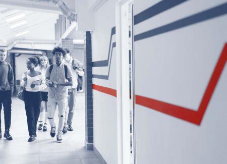 high school students walk to class
